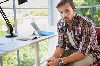 man sitting in office