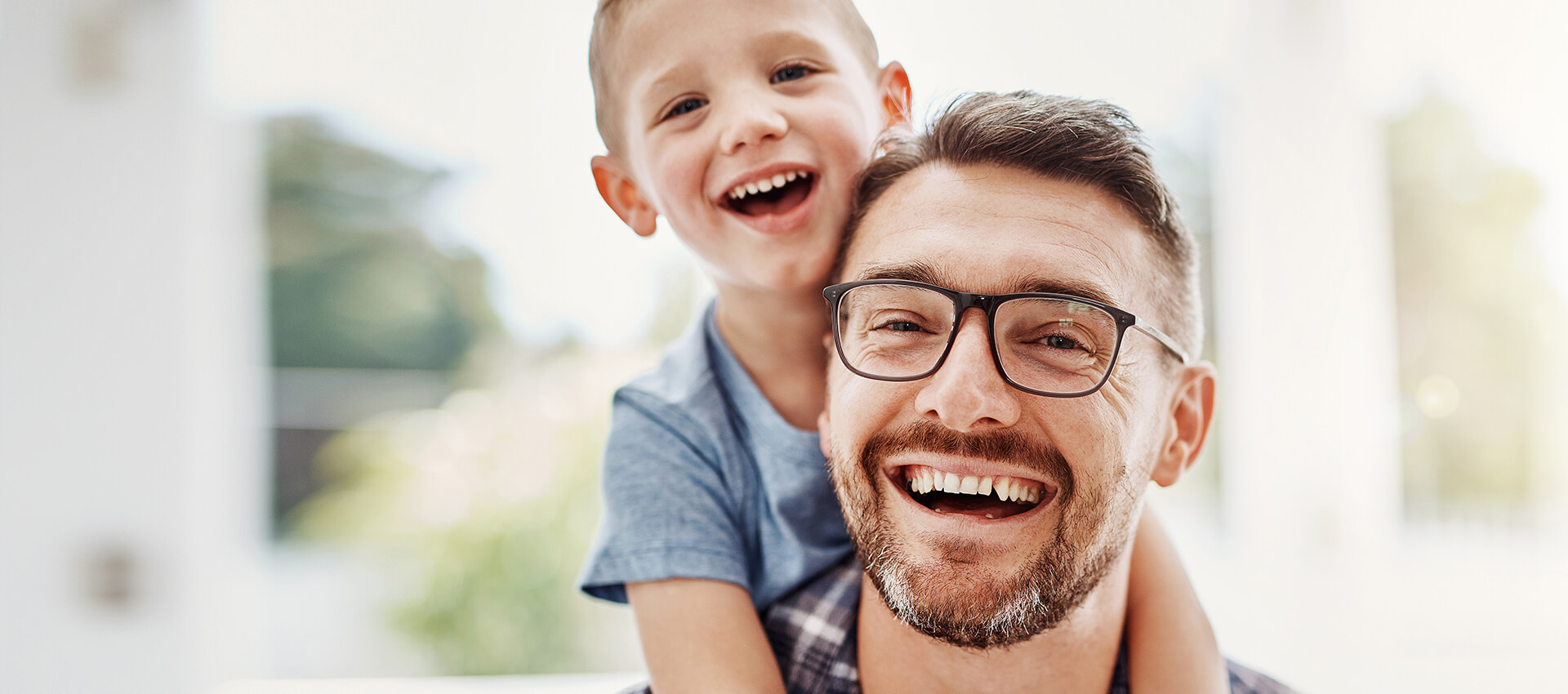 smiling-man-with-son